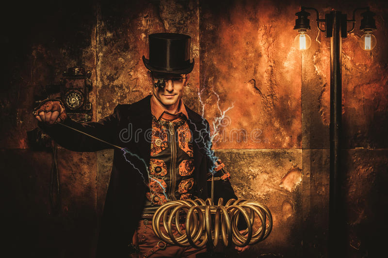 Steampunk man with Tesla coil on vintage steampunk background.  royalty free stock photos