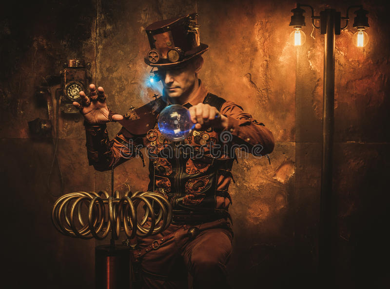 Steampunk man with Tesla coil on vintage steampunk background.  royalty free stock photography
