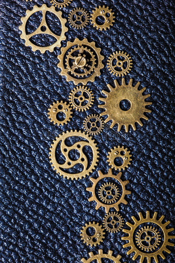 Steampunk mechanical cogs gears wheels on leather background royalty free stock photos