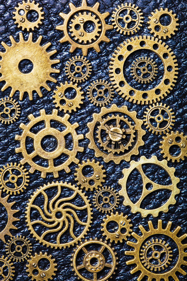 Steampunk mechanical cogs gears wheels on leather background.  stock images