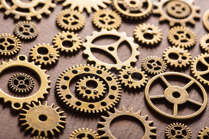 Steampunk mechanical cogs gears wheels on wooden background.  stock photo