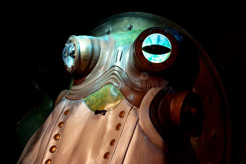 Steampunk mechanical octopus with glowing eyes royalty free stock photo