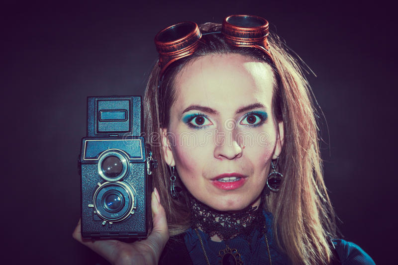Steampunk with old retro camera. royalty free stock photos