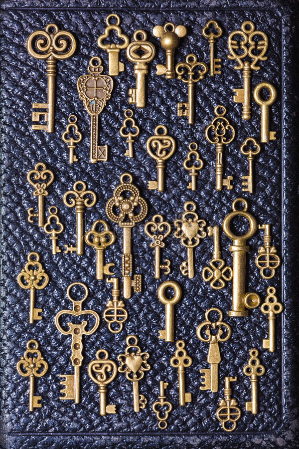 Steampunk old vintage metal keys background on leather.  royalty free stock photography