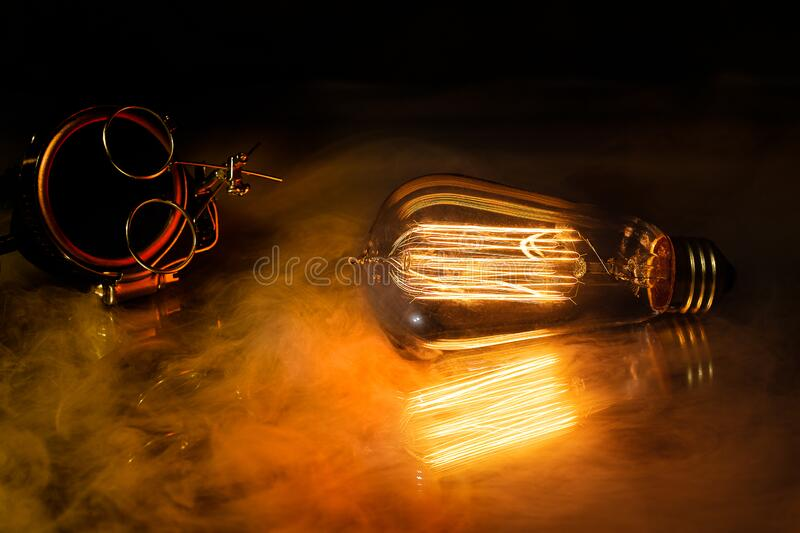 A steampunk scene with a victorian feel, bathed in warm orange light produced by the edison style lightbulb. A steampunk scene with a victorian feel,  bathed in royalty free stock photos