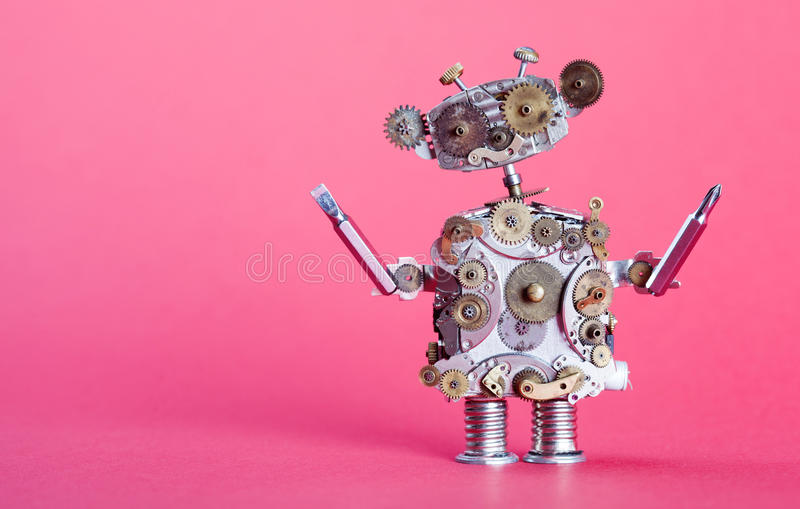 Steampunk service robot concept. Repair man with drivers. Aged gears, cog wheel hand clock parts mechanism. Shabby. Scratch metal texture. Pink background royalty free stock image