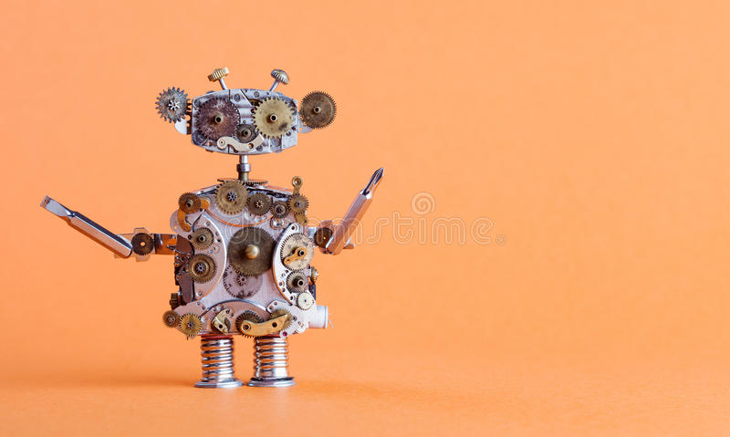 Steampunk style robot handyman with screwdriver. Funny toy mechanical character, repair service concept. Aged gears, cog. Wheel hand clock parts. Shabby grunge stock photography