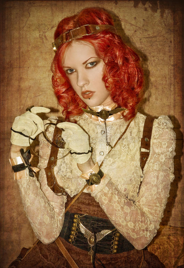 Steampunk Victorian Girl. With red hair and red lips royalty free stock photography
