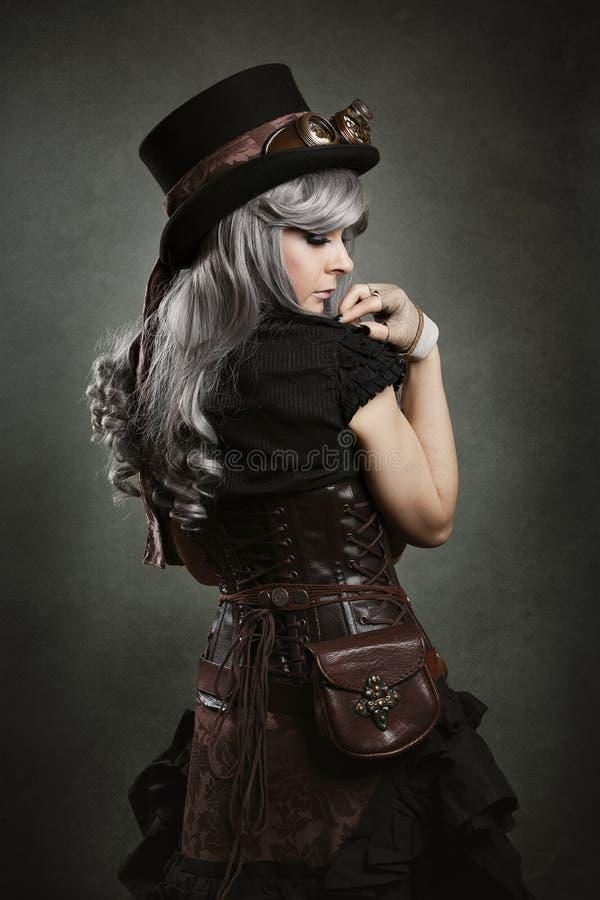 Steampunk woman back stock photo