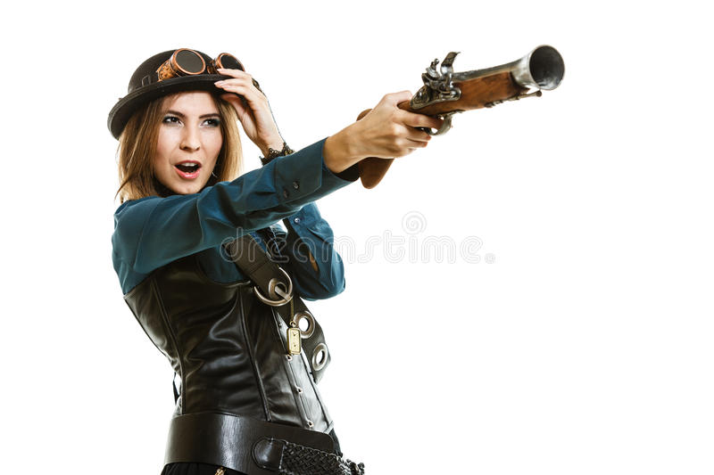Steampunk woman holding a gun isolated. stock photography