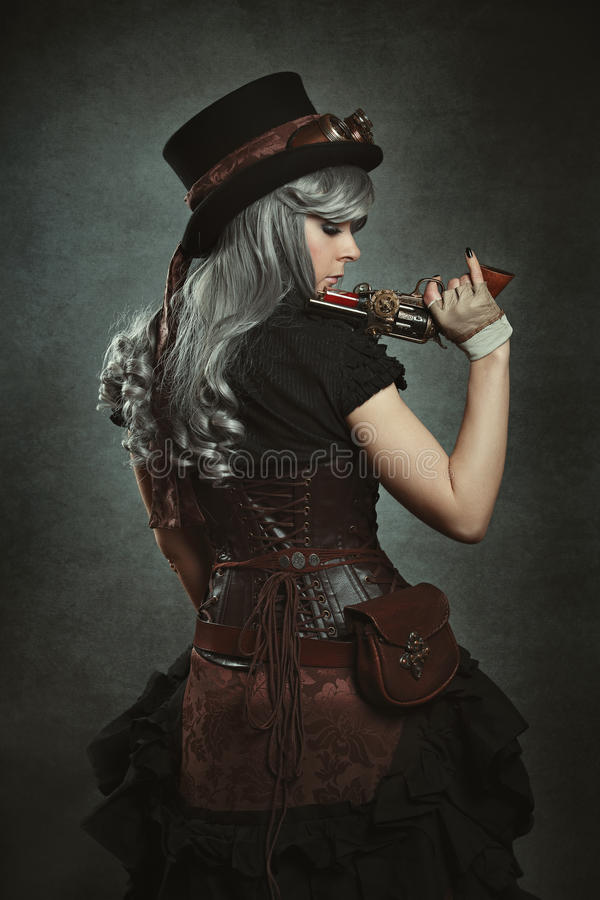 Steampunk woman with mechanical gun stock image