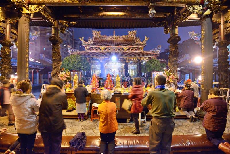Stearinljus för buddistisk tempel arkivfoto