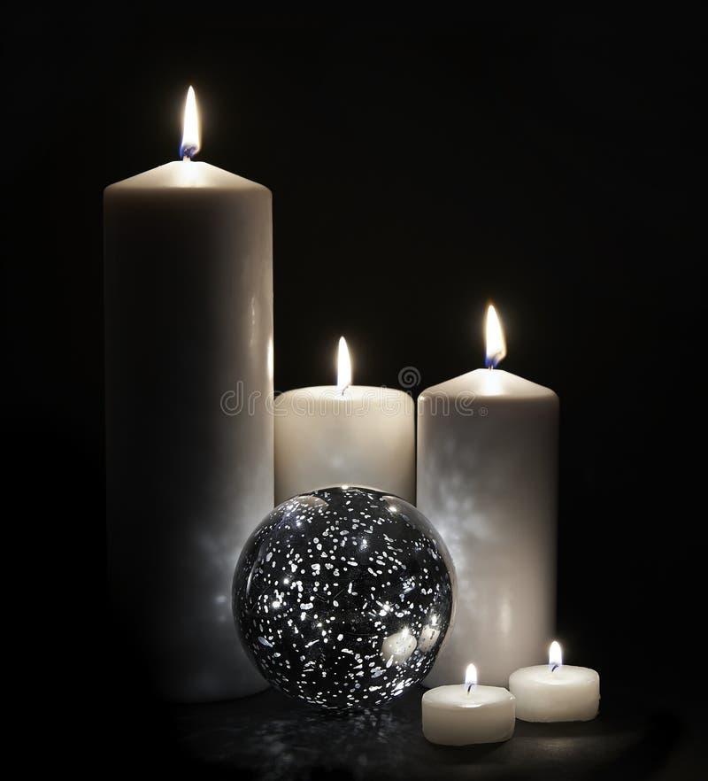 Stearinljus och ljus orb royaltyfri bild