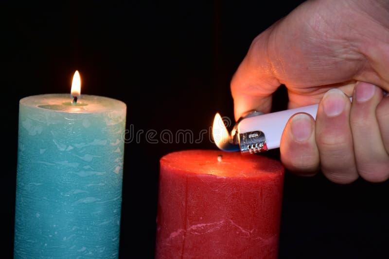 Stearinljus och tändare, royaltyfria bilder