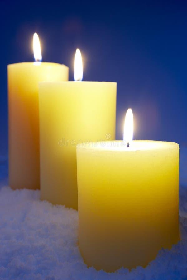 stearinljus snow royaltyfria bilder