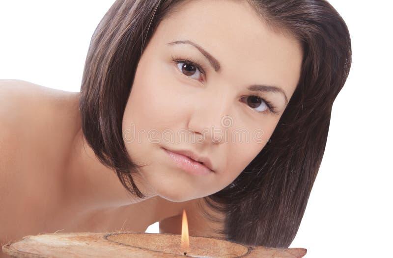 stearinljus som ser till kvinnabarn royaltyfri foto
