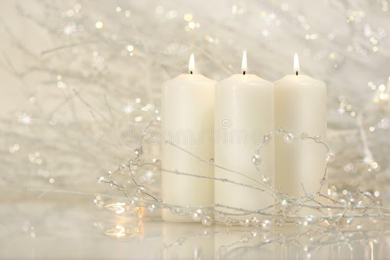 stearinljus tre white royaltyfri foto