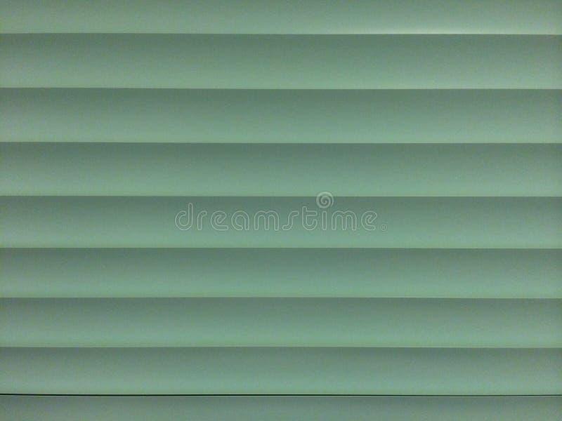 Stecche delle veneziane di verde prudente fotografia stock
