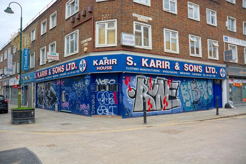 Stedelijke kleinhandelsgraffiti, straatkunst, Baksteensteeg, Oost-Londen royalty-vrije stock afbeelding