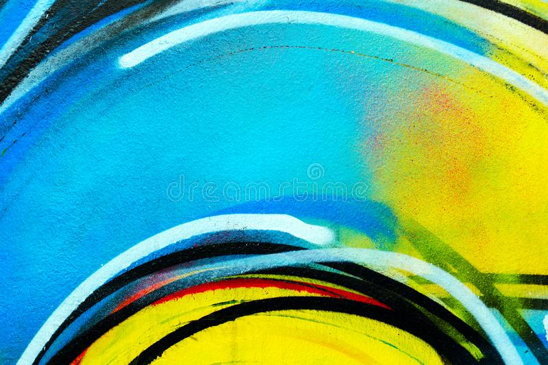 Stedelijke muur - heldere kleurrijke achtergrond Graffiticlose-up stock afbeelding