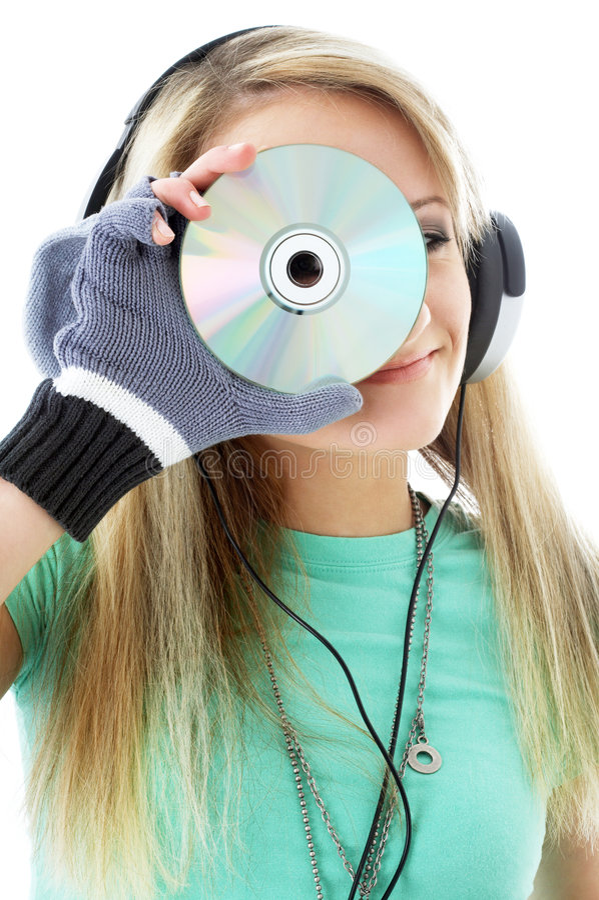 Stedelijke tiener die in hoofdtelefoons CD houdt stock afbeelding