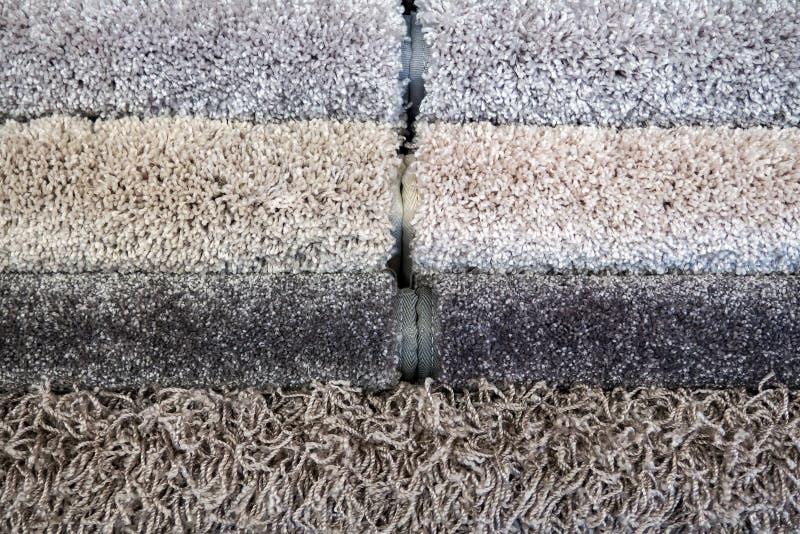 Steekproeven van kleur van een tapijt, grijze broodjes stock foto's