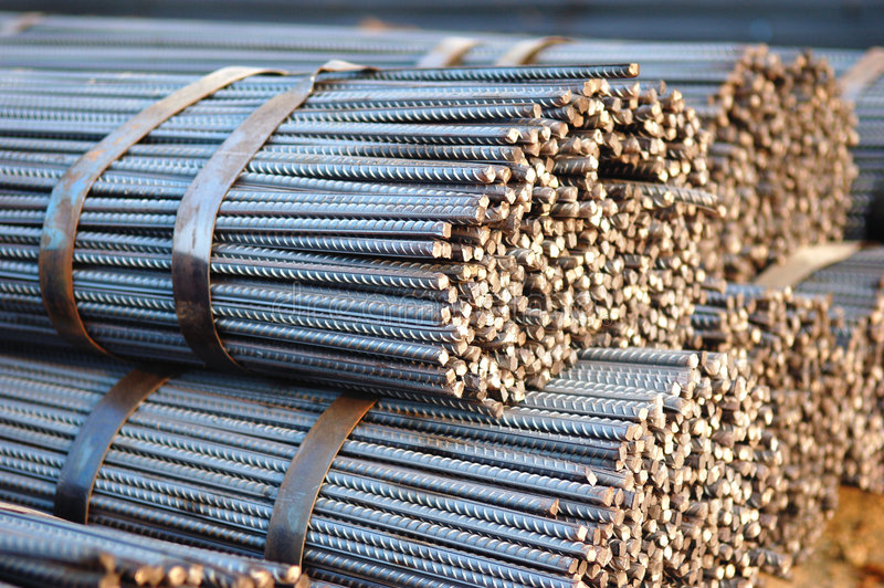 Steel. A tied bundle of cold steel bars on construction site stock photos