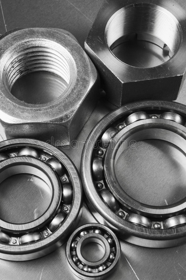 Steel and aluminum menagerie. Mechanical components against brushed aluminum stock photography
