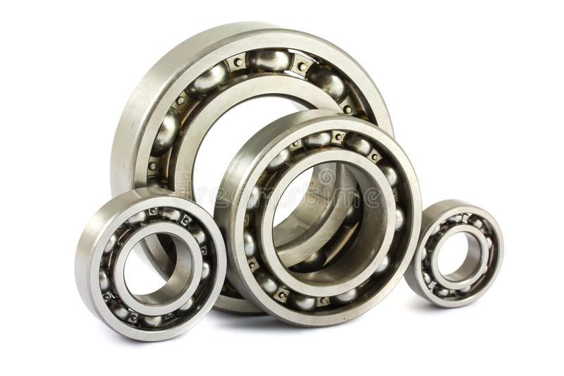 Steel ball bearings. Four steel ball bearings isolated on a white background royalty free stock image