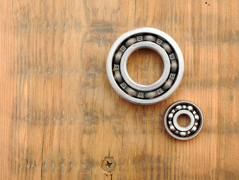 Steel ball bearings. On wooden background royalty free stock image