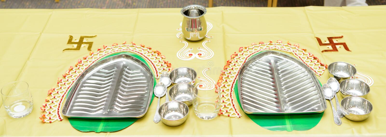 Steel Banana Leaf plates and bowl setup for traditional lunch or dinner stock photos