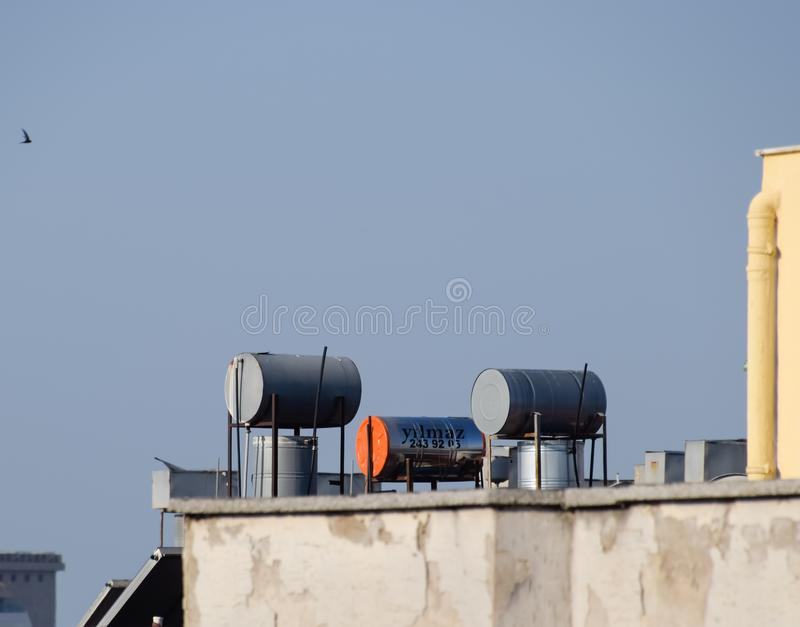 Steel barrels of boilers with water on the roof of a building to heat stock photos