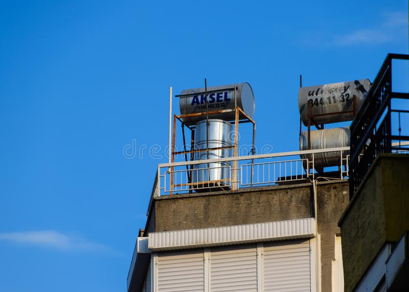 Steel barrels of boilers with water on the roof of a building to heat royalty free stock photography