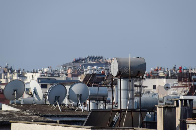 Steel barrels of boilers with water on the roof of a building to heat royalty free stock image