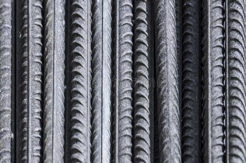 Steel bars used in construction works. Abstract background of iron bars, used in construction works and concrete stock image