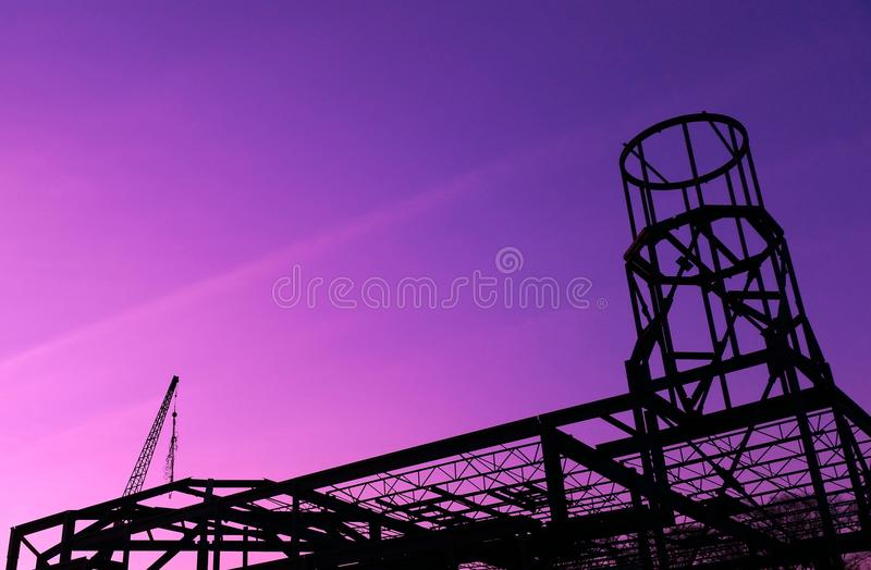 Steel beam building under construction. A steel beam shell of a church being built on construction site royalty free stock image