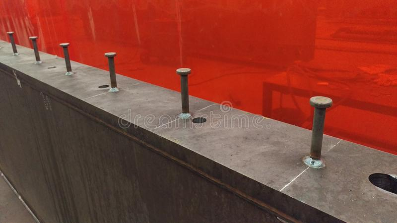 Steel beam with pinbolts. Steel beam with welded pinbolt at workshop manufactured in a metal factory stock photography