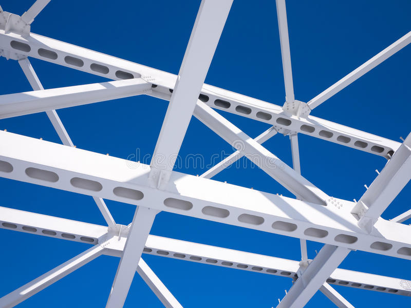 Steel beams against the blue sky stock photography