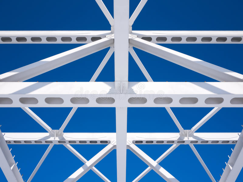 Steel beams against the blue sky. Fragment construction site stock photos