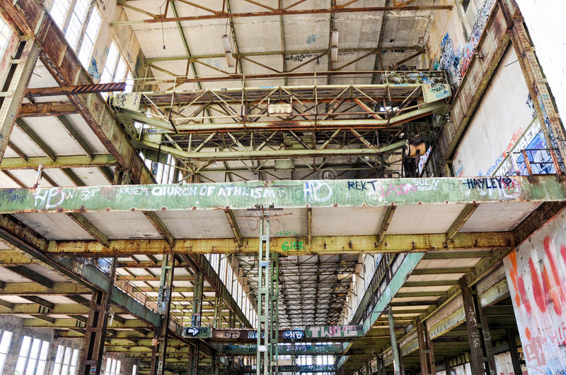 Steel Beams and Gantry Crane: Old Power House. FREMANTLE,WA,AUSTRALIA-JANUARY 10,2016: Rusted gantry crane with tagged structural steel beams at the Old Power royalty free stock photos