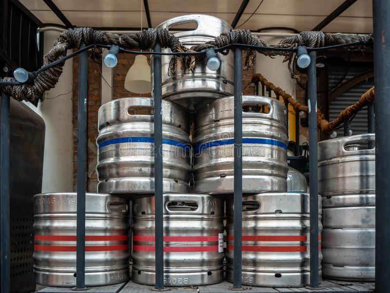 Steel beer kegs on the back of the restaurant. Stack of stainless steel beer kegs on the back of the restaurant stock images