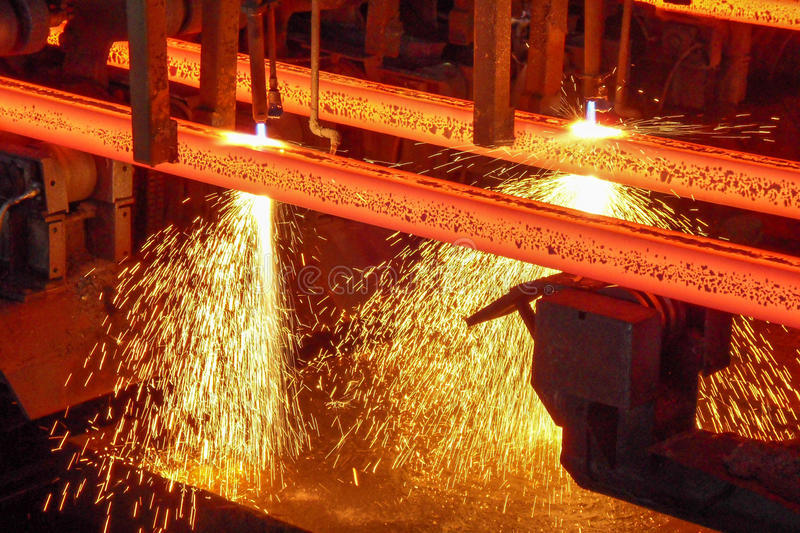 Steel billets at torch cutting. Steel billets at a continuous caster are cut to length stock photo