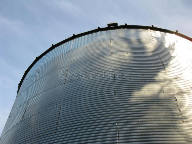 Steel bin. Looking up at a steel bin against a blue sky royalty free stock photography