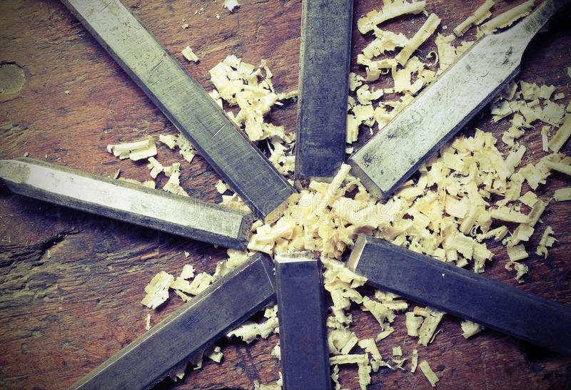 Steel blades many chisels and sawdust chippings with vintage ef royalty free stock photography