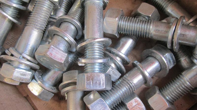 Bolts with nuts and washers. Steel bolts with nuts and washers large royalty free stock image