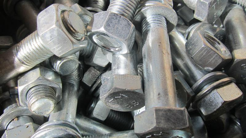 Bolts with nuts and washers. Steel bolts with nuts and washers large stock photography