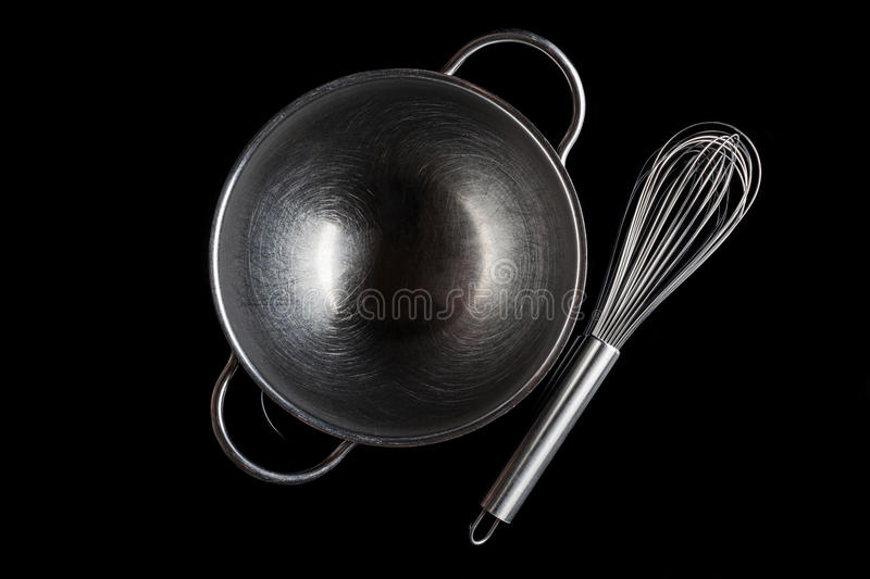 Steel bowl with whisker from above with reflection black royalty free stock photography