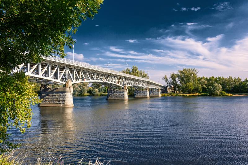 Steel bridge across the river Elbe in the town of Litomerice in the Czech Republic. Bridge in summer sunny day. Metal construction of arched bridge with royalty free stock photography