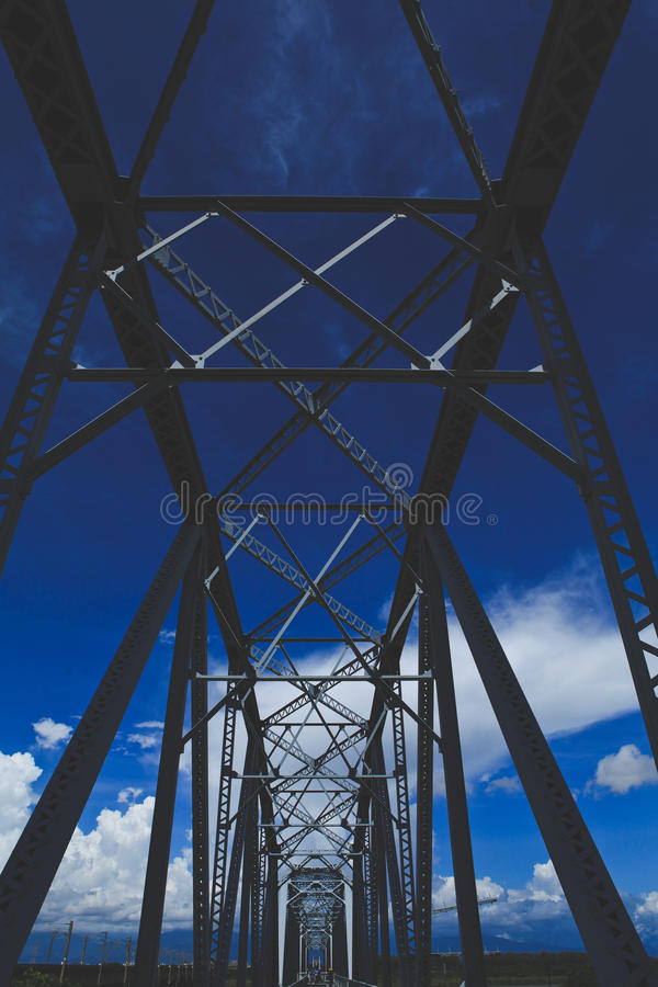 Steel bridge with blue sky background royalty free stock photography