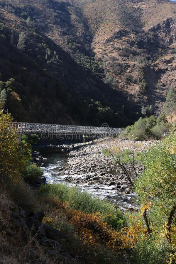 Steel bridge crossing the Merced River Canyon, Highway 140, northern California. Due to the Ferguson rock slide, a temporary bridge spans the river.  This site stock image